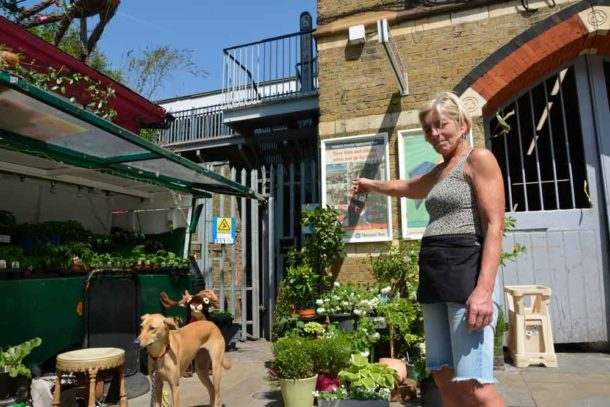 Elaine Partleton points out the sub-station next to her shop