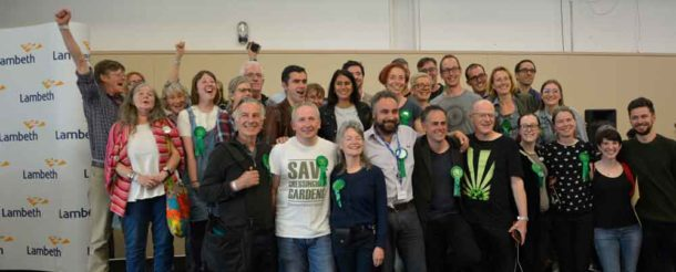 Green candidates and supporters celebrate at the count