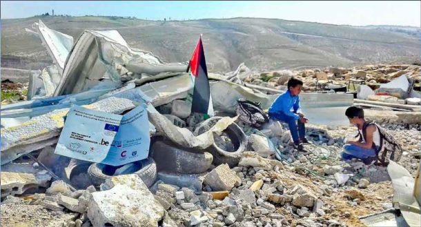 November 2017: Children play in the rubble of Abu Nuwar school