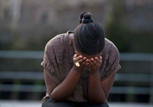 Young Black woman in despair