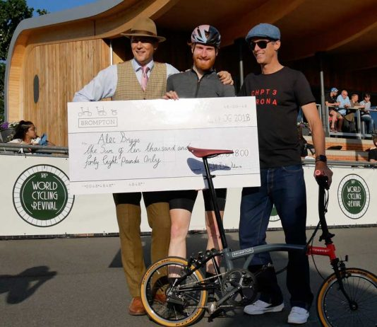 Alex Briggs with cheque for winning Brompton race