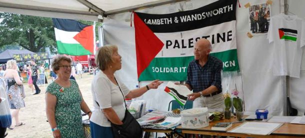 Brixton Hill councillor Adrian Garden on the Palestine Solidarity Campaign stall
