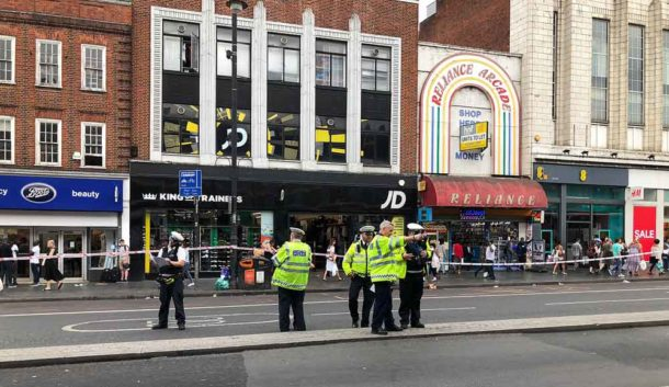 Police investigators on Brixton Road