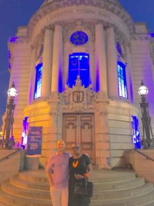 Councillors Ed Davie and Jacquie Dyer outside the illuminated tone hall last night