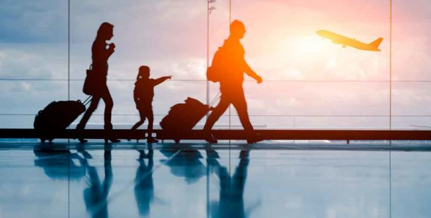 Couple with child at airport