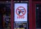 Stop knife gun sign in Brixton shop window