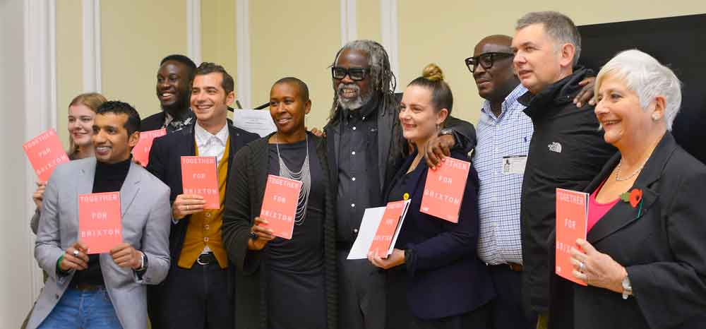 BID team members, councillors and board members celebrate the result in Lambeth town hall. Centre: BID director Michael Smith with co-chairs Laverne Walker of Sackville Travel (to his left) and Elly Foster of Satay Bar, Market House and Nanban