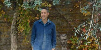 Sculptor Antony Padgett with his bust of Vincent van Gogh