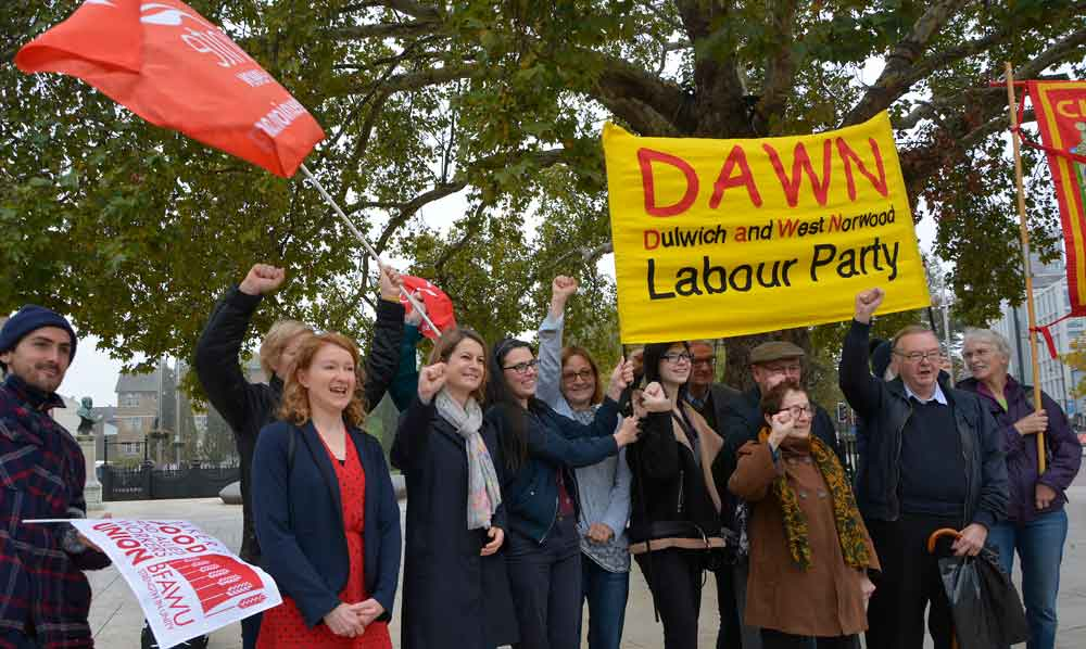 Local councillor Scarlett O'Hara (red dress) and local MP Helen Hayes (scarf) visited the rally in Windrush Square