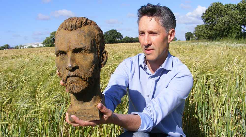 Anthony Padgett with his sculpture of Vincent van Gogh