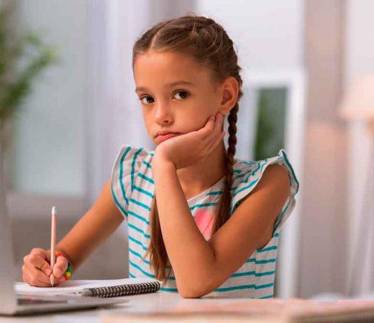 Miserable girl studying
