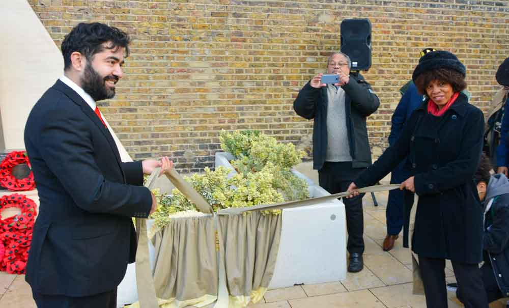 Lambeth deputy mayor Ibrahim Dogus and writer and publisher Margaret Busby OBE prepare to unveil a plaque for memorial sponsors and Brixton institution Healthy Eaters