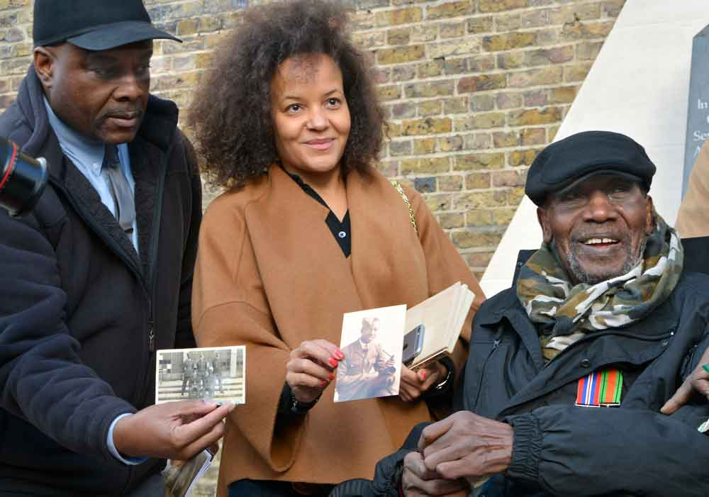 Winston Whyte today with friends and family members displaying pictures of him in the RAF during the Second World War