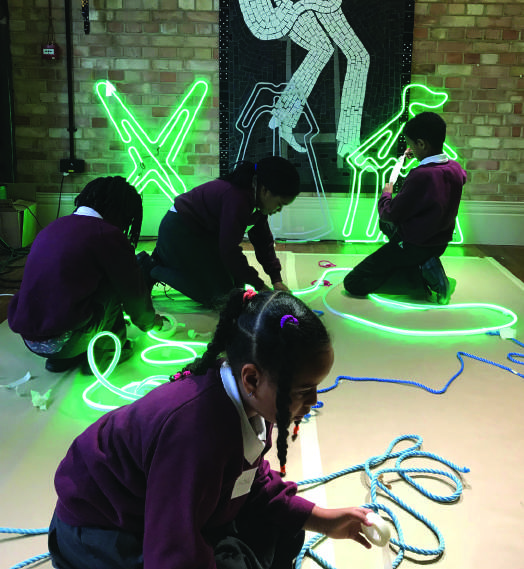 Children from Hill Mead Primary with their illuminations