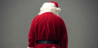 Christmas can be a trying time. Photo of a santa with his back to camera