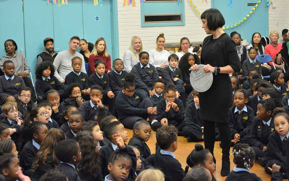 Executive head teacher Jayne Mitchell discusses the time capsule with pupils
