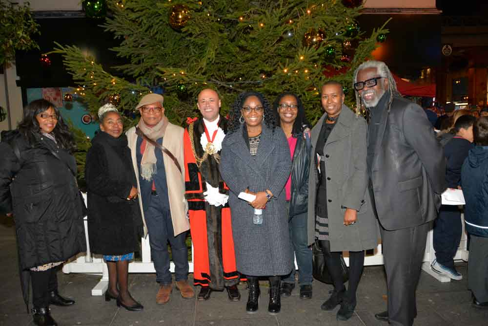 At the switch on: Cllr Marcia Cameron, Cllr Sonia Winifred, Cllr Donatus Anyanwu, mayor Christopher Wellbelove, Mosaic's Beverley Randall, Mosaic poet Angela, Cllr Jacqui Dyer, Brixton Business Improvement District director Michael Smith