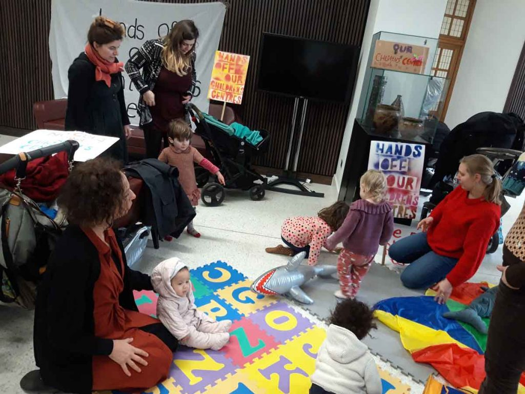 Protesters and their children in the town hall