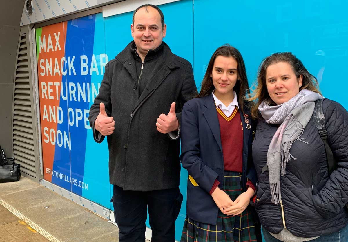 Cafe Max owner Zelia Alves Figueira outside the arches with husband and daughter