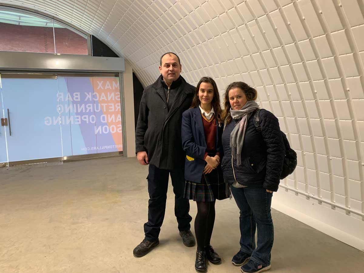 The Figueira famíly inside the completed Arch that will house Cafe Max
