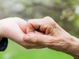 photo of two hands together to illustrate carer support