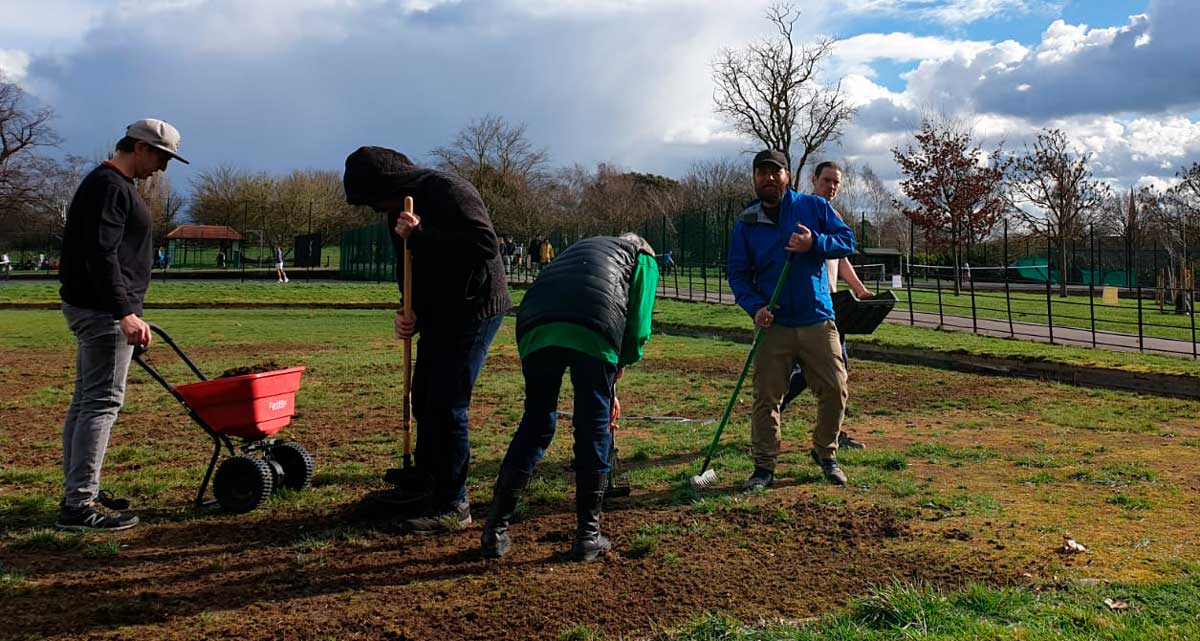 Bowls volunteers tending the grass at Brockwell Park