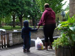 Mother and child with foodbank parcel