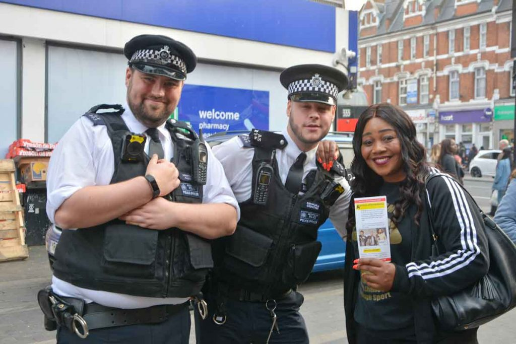 Pastor Lorraine Jones with Brixton PCs Joe Farrell (left) and Jake Crowther