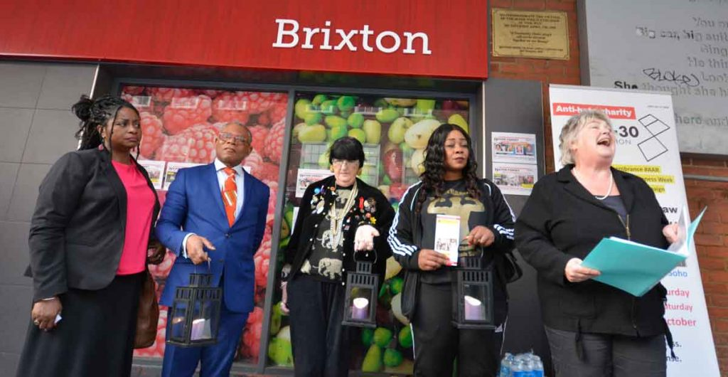 Listening to LGBT poet laureate Trudy Howson (right) reading her poem written for the occasion (l-r) Cheryl Lewis, of the Lambeth Disability Hate Crime Project; Donatus Anyanwu, representing the mayor of Lambeth; HCAW member Carol; and Pastor Lorraine Jones of Dwaynamics