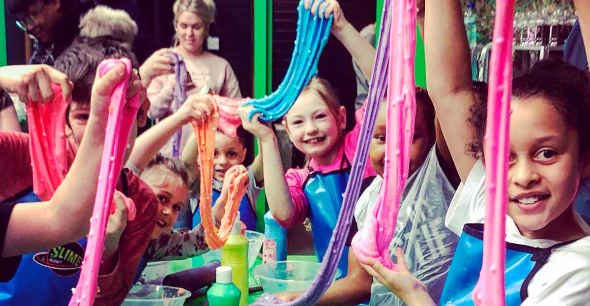children playing with giant slime at Planet Slime Loughborough Junction