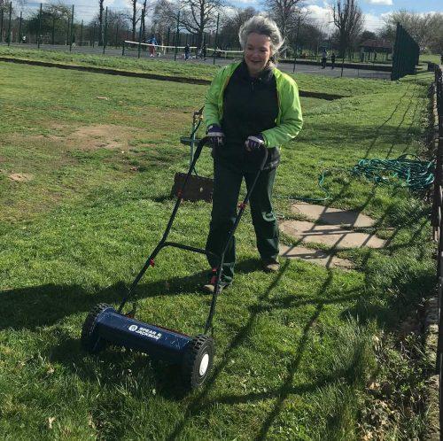 Volunteer Becca mowing at the Sylvan Bowling Club Brockwell Park