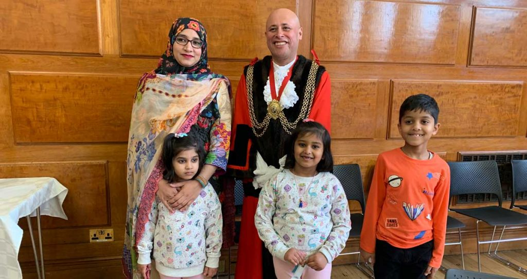 mayor in robes with family