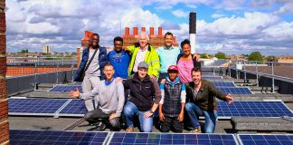 volunteers with solar panels