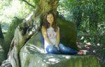 Yoga teacher Helen sitting under tree