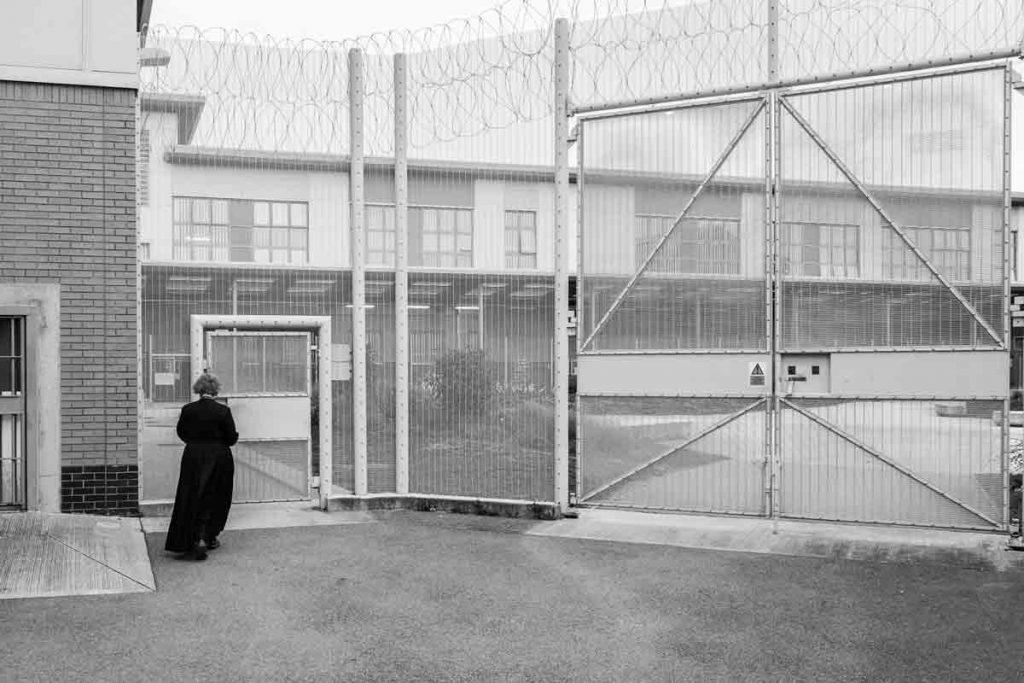 Woman priest entering a prison