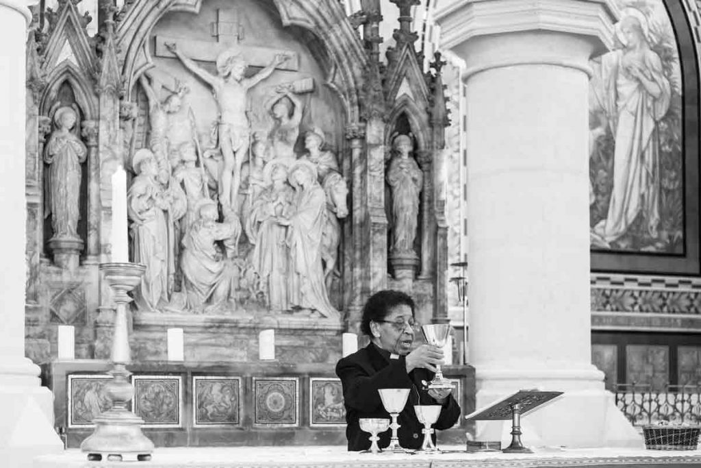 Woman priest in churc