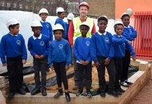 children outside in building site