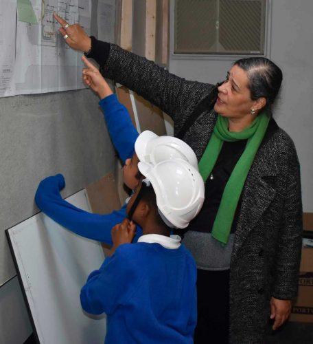 Children looking at blueprints
