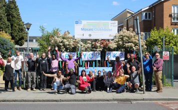 mental health charity Mosaic's staff and members outside the club for Mental Health Week