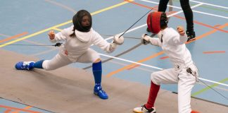 two fencers mid-battle
