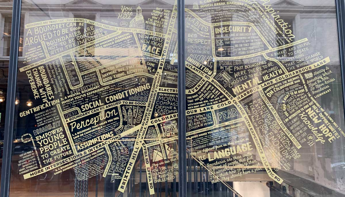 Promo for Brixton Boundaries exhibition on windows of the Department Store