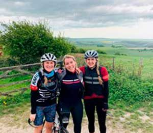 Megan Kent with friends in cycle gear