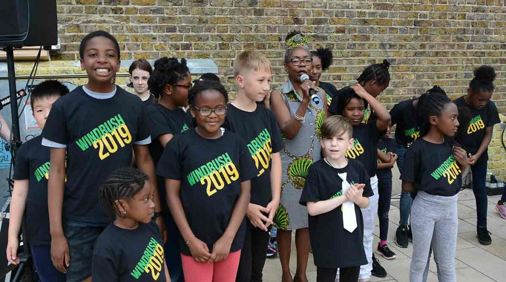 Cllr Winifred with young performers at this year's Windrush Day event in Brixton's Windrush Square