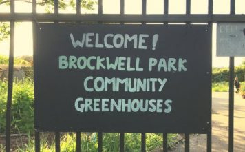 sign saying welcome to brockwell park community greenhouses