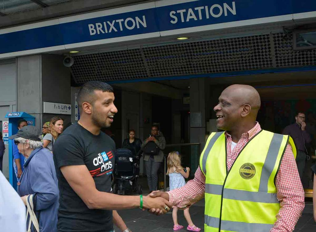 Ferndale ward councillor Irfan Mohammed greets Michael Groce at Brixton Tube station