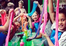 Children stretching slime dough