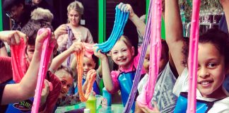 Children stretching slime dough