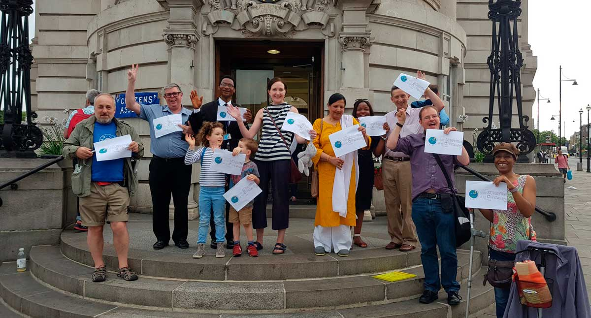 St Martin's residents celebrate victory on steps of Town Hall