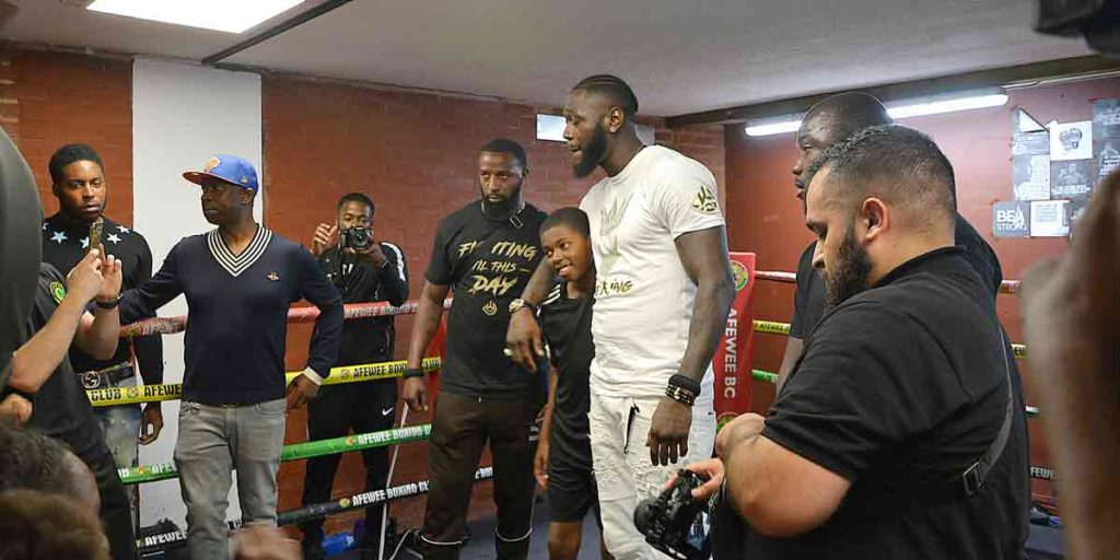 Deontay Wilder with boy