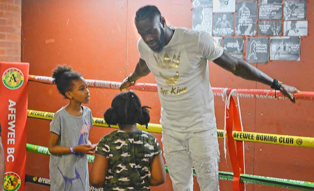 Deontay Wilder with young gils in Boxing ring